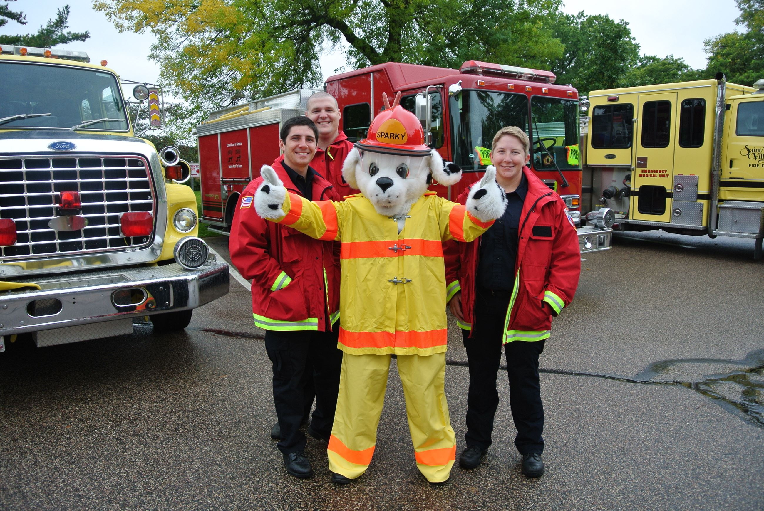 Sparky with firefighters